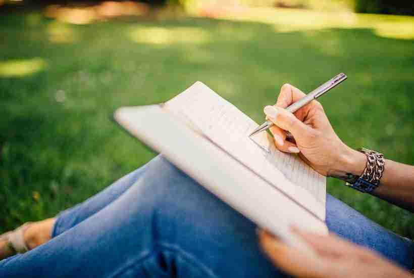 Sitting on lawn writing in my blog